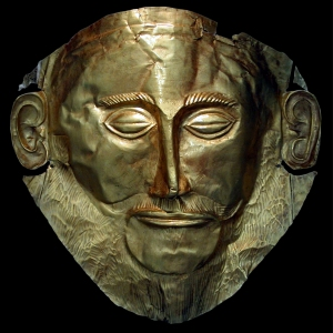 Gold Funerary Mask, known as the  'Mask of Agamemnon,' ca. 16th century BCE. Found in 1876 by Heinrich Schliemann in Tomb V at Mycenae, Greece. Currently on display in the National Archaeological Museum, Athens. Source: Wikimedia Commons