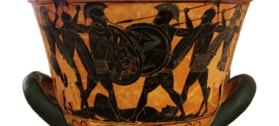 Closeup of Athenian Black Figure calyx krater depicting a battle over a corpse Probably that of Patroklos. In the manner of Exekias, ca. 530 BCE. Found at Pharsalus, Phthia, Thessaly. National Archaeological Museum, Inv. 26746 Athens, Greece. Source: Wikimedia Commons