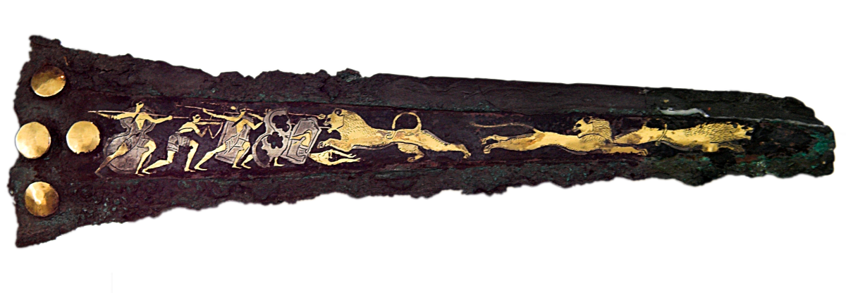 Late Bronze Age Mycenaean dagger, bronze with inlaid silver and gold depicting warriors hunting lions, ca. 16th century BCE. Source: Wikimedia Commons
