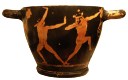Attic Red-Figure Skyphos, ca. 470 - 460 BCE depicting two young men performing acrobatic stunts at a symposium. Source: Wikimedia Commons
