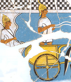 Two helmeted warriors and chariot on a Mycenaean fresco from Pylos, ca. 1350 BCE. Source: Wikimedia Commons