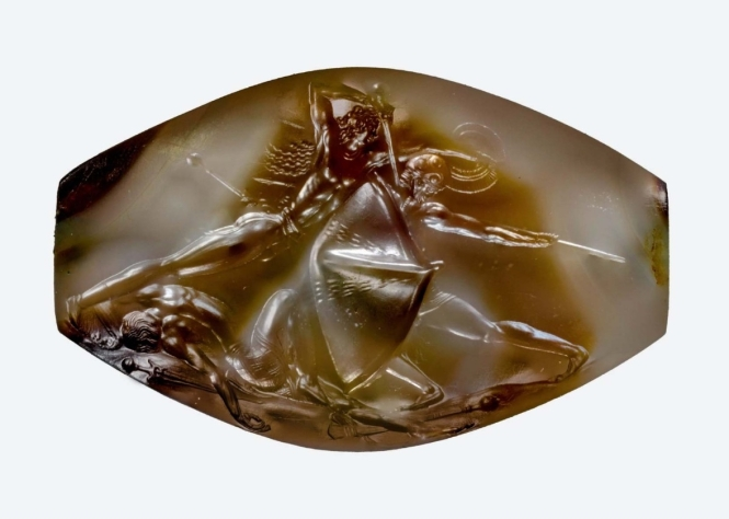 "A tiny sealstone from the tomb of the Griffin Warrior found by UC archaeologists Davis and Stocker depicts mortal combat in exquisite detail. Archaeology Magazine called the seal stone ""a Bronze Age masterpiece."""