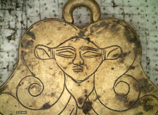 Gold pendant in the newly unearthed tholos tomb at Pylos featuring Hathor, an Egyptian goddess protector of the dead